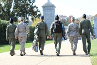 photo of women service members walking toward WIMSA